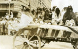 Native American children riding in a wagon in First American Pageant parade