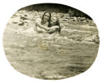 Adele Requadh and Julia Bletcher sitting together in a river