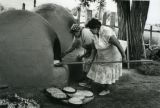 Baking bread for feast day, 1985
