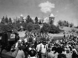 Crowd at dedication ceremony for Armand Hammer United World College with Montezuma Castle in...