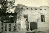 Babs in front of home, Santa Fe, N.M., 1918-1919